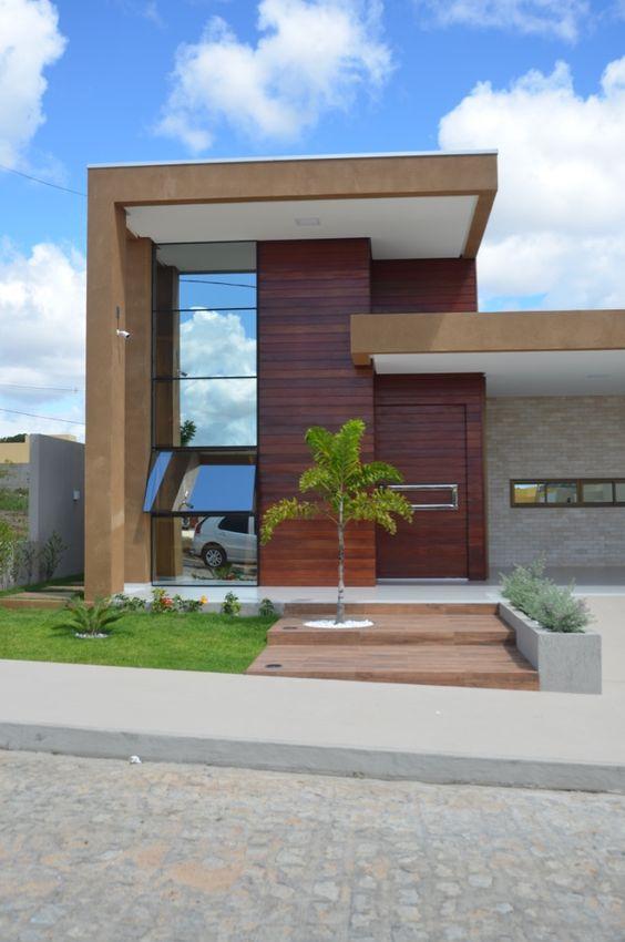 Ideas consejos para hacer fachada casa MODERNA Fachada de líneas rectas con madera y vidrio reflectante bronce