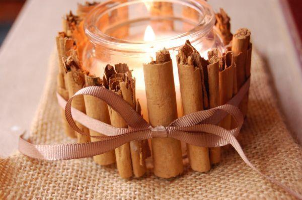 velas-decorativas-con-canela-con-lazo-marron